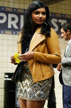 (the mindy project) mustard leather jacket and sequin skirt