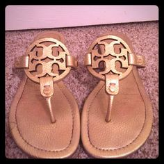Gold leather Tory Burch Miller flip flops Great condition! Leather is a tiny bit worn, on bottom due to wear, see pictures. Minor scratch on top right side of right shoe. Not very noticeable. Tory Burch Shoes Sandals