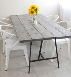 Poppytalk: 6 DIY Tables to Try / Five 2x8 boards and LERBERG trestle legs from IKEA were used for this DIY by Ez of Creature Comforts.