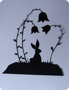 Here is a free papercutting pattern of a bunny sitting amongst flowers for you! (I think he's resting before the big day!