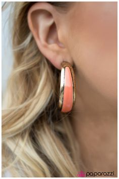 "Gypsy Rumba  A chunky brass hoop curls around the ear in a bohemian inspired fashion. The perfectly distressed brass finish is complemented by a strip of Peach Echo paint that adorns the center of the hoop for a playful pop of color. Earring attaches to a standard post fitting. Hoop measures 1 5/8"" in diameter.  Sold as one pair of hoop earrings."