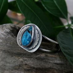 This One of a kind handmade sterling silver cuff bracelet holds a deep blue Nacozari turquoise from Mexico The face of the cuff has a textures backplate with a layered hand sawed detail designed to emphasize the stone The bracelet is designed to provide enough support to hold the