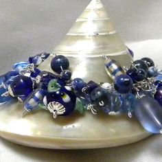 https://www.etsy.com/treasury/MTg3NzM2Mzh8MjcyNDgyMzUwMg/one-last-trip-to-the-beach Cluster Bracelet Blue Cluster Bracelet Beaded by marilyn1545, $40.00