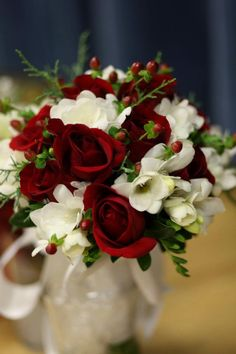 The beautiful flower arrangements were done by