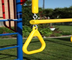 Lifetime Swing Sets - 90177 Primary Color Money Bar Swing Set with Slide.  This picture shows the trapeze bar by a pole.