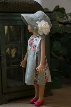 """""""Woodland Rose"""" by LadybugsDollDesigns. This shows the denim hat with its trim of a large ribbon rose. The green denim hat is lined with the rose material of the dress."""