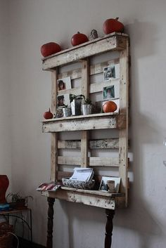 diy pallet furniture I am definitely against coffee tables & with my 2 children (my 4yr old & my husband) - I don't always get to have nice things out & displayed (without fear of them getting knocked off or a bunch of junk just stacked on top). But this idea allows me to display thins & a seances of decor without taking up too much space....