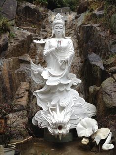 Statue at the top of the 10,000 buddhas monastery, a Buddhist temple in Sha Tin, Hong Kong.