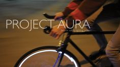 Project Aura: Bicycle Safety Lighting System by Project AURA. Riding at night can be a daunting and dangerous task; many biking commuters are faced with the issue of being obscured when riding on the streets. Visibility at night is a vital component of biker safety, hence the need for reflectors and attachable lights. However, some of these devices are not always effective especially from the side.