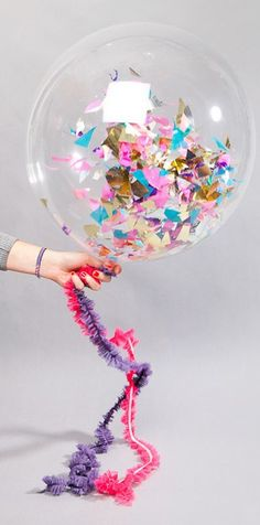 DIY Fun decorative balloons - Decorate them with paper and glitter.