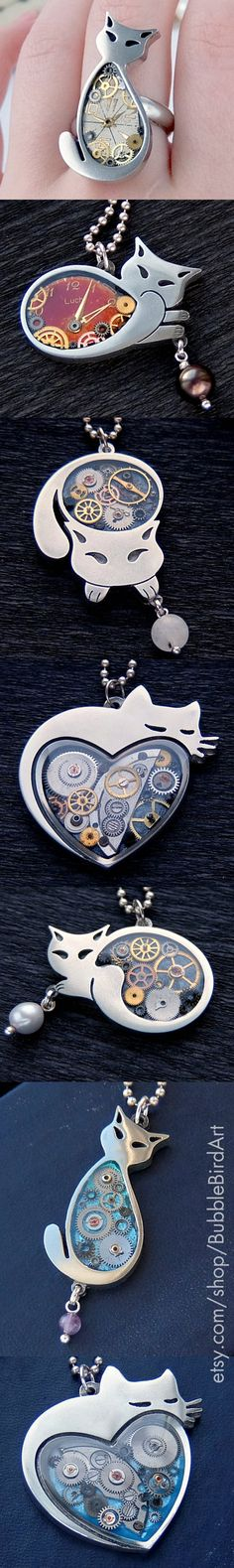 Close-ups of some of steampunk cat pendants by Bubble Bird Art