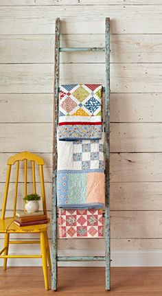 I love the idea of using a cool old ladder to display my quilts!