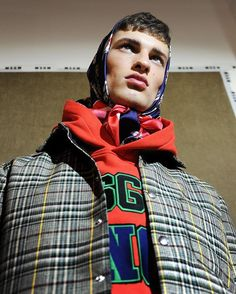 A look at the Men's #FallWinter2017 collection through the special backstage project curated by @DustMagazine for #MSGM and lensed by @Luigi_Vi & @LucaGuarini. @DavidTrulik wears colourful hunting checks, the college-inspired 'MSGM SINCE' hoodie and the iconic sneaker print silk headscarf. See you soon in stores and online. #MSGMFW17 #DustMagazine #MassimoGiorgetti