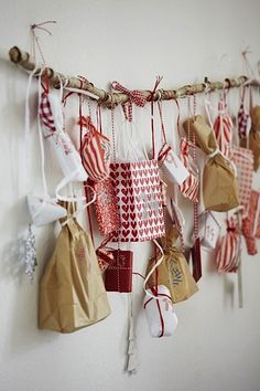 advent calendar ideas with wrapped gifts tied to branch