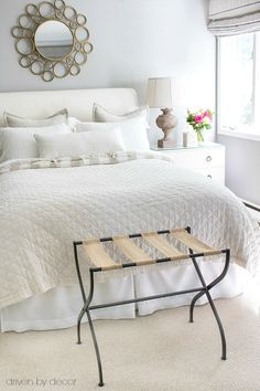 Guest bedroom in neutrals with luggage rack - a guest room must have!