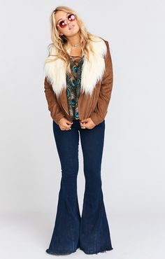There is no way you can go out with Amelia Jacket and not feel just about almost famous. Zipper side pockets are ideal for stashing concert tickets and backstage passes. If she's not on stage by the end of the show, then she is already at the after party picking out the perfect playlist. Your favorite boots and high waisted jeans are a perfect match for this little rockster.    *Self and Lining: 100% Polyester *Zipper pockets on sides *Zipper closure  *Faux Fur Collar:70%…