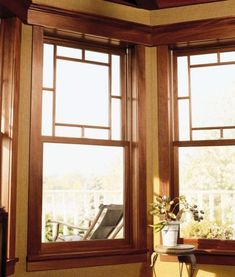 These solid double-hung wood windows have a decorative wood grid pattern on the upper sash.