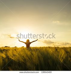 Teenage girl enjoy with sun in the evening glow - stock photo