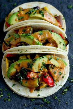 Grilled vegetable tacos (vegan and gluten free) are completely irresistible and satisfying when tossed in a light peanut sauce and topped with avocado slices.