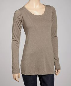 Slip into this trendy top for a wear-everywhere staple. Combining a scoop neck silhouette with a classic shade, it embodies casual-chic style.50% cotton / 25% rayon / 25% polyesterMachine wash; tumble dryImported