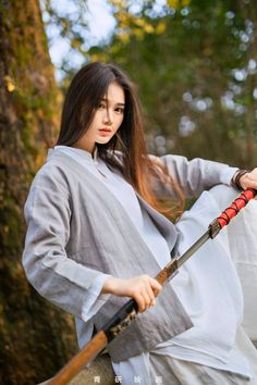 f Monk Katana forest hills Asian Faction Hanfu, Katana Girl, Female Samurai, Poses References, Warrior Girl, China Girl, Chinese Clothing, Japanese Culture, Chinese Culture