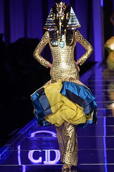 Christian Dior - S/ S 2004. Very Egyptian inspired / use of Nemes Headdreess / Gold, blue and yellow color / Shape of sheath dress