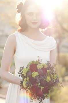 Amelie Inspired Shoot. Red, purple and green bouquet by Layers of Lovely Floral Design