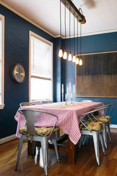 dining room  light fixture/candlesticks/painting/wall color
