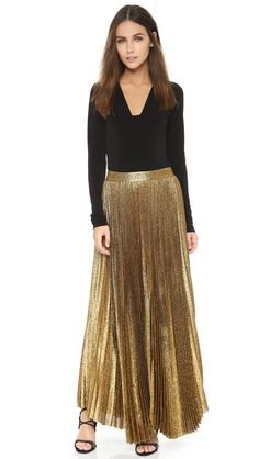 A glamorous alice + olivia maxi skirt cut from sparkling lamé. Crisp pleats lend a vintage feel. Exposed back zip. Lined. Pleated Maxi, Sequin Skirt, Golden Glitter, Holiday Looks, City Style, Alice Olivia, Crisp, Autumn Fashion, Glamour