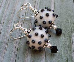 Handmade porcelain bead earrings with jet black Swarovski Crystals, Sterling Silver ear wires.  #handmade #womensfashion #fashion #jewelry #beads #earrings