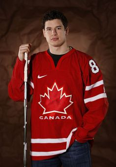 Sidney Crosby of the Pittsburgh Penguins poses for a portrait in his Team Canada 2010 Olympic jersey on February 2010 at Mellon Arena in Pittsburgh, Pennsylvania. Hockey Girls, Hockey Mom, Ice Hockey, Rangers Hockey, Hockey Stuff, Field Hockey, Hockey Players, Olympic Team, Hockey