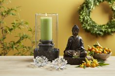 "Buddha Candle Holder    P9168   $75.00 Lotus Flower Votive  P91289  $45.00/set of 2 Harmony Fountain  P91260FCAU   $130.00 Buddha sits with his right hand raised, palm facing out, fingers upright and joined. This symbolizes peace and protection. Resin with bronze finish. 9""h, 6""w.  If you would like to get your collection for free ask me how on michellemybell4@hotmail.com Independent  Partylite Consultant"