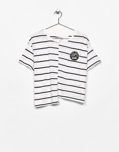 Asymmetric striped T-shirt with patch. Discover this and many more items in Bershka with new products every week