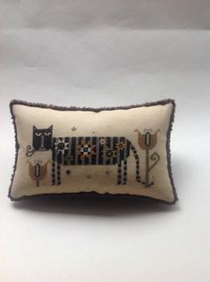This is Olga the cat by Plum Street Samplers.   THIS IS A RESERVED LISTING FOR SHANNON.