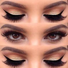 Gold eye shadow and black winged eyeliner.