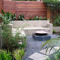 Horizontal fence with cement features, gravel and stepping stones - Houzz