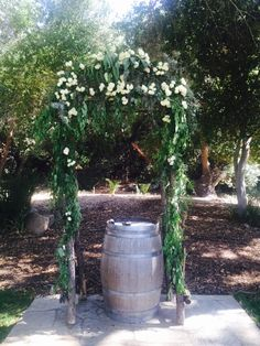 Rustic Arch of greens and roses Temecula Creek Inn