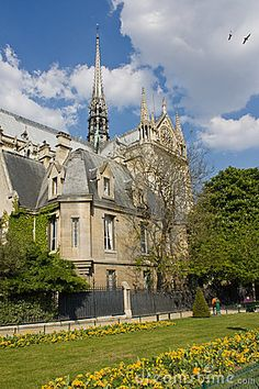 The cathedral Notre-Dame de Paris (the southern facade) and the nearby garden.