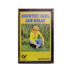 Jan Holly: Country Girl. Fin utgivelse med den engelske country-artisten Jan Holly. Kassetten er testet og fungerer slik den skal. Ikke av de mest vanlige å finne på kassett.