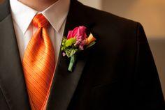 orange tie, black suit, more formal