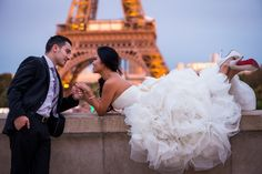 Bride and groom playing in front of Eiffel Tower