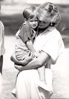 A loving cuddle for Harry Diana carries a two-year-old Harry while holidaying with the King and Queen of Spain in August The shot was taken at the King's Villa in Palma, Majorca.