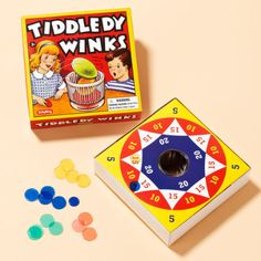Tiddledy Winks Game The classic game is still loads ofl fun. Use the discs to flip your chips into the center and score points