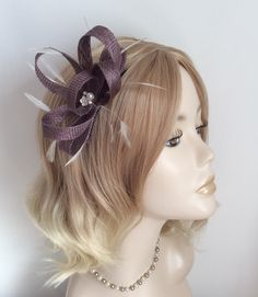 A NUDE PINK and WHITE Fascinator chiffon flower inset with crystals.and pearls Feathers Made with sinamay on a comb