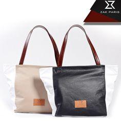 BORA BORA – BLACK & WHITE ¿Quieres un bolso moderno y cómodo? lo tenemos. El color coral combinado con blanco combinará excelente con unos blue jeans y cualquier camisita, y te darán el toque divertido que buscas. ¡Atrévete! medidas (cm): 50 x 13 x 32  #BoraBora #Carteras #Moda #FashionLove #ZakLove