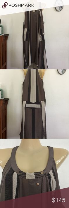 """Belstaff Silk Dress Belstaff Silk Midi Dress.  Made in Italy.   Snaps down the front.   Brown, black and beige multi colored.  2 flap pockets at the waist. Size 42 converts to USA medium  Measurements laying flat:   Armpit to armpit 19.5"""" Waist 22.5"""" Hip. 23"""".   Length 40""""  Good used condition!  BinP1 Belstaff Dresses Midi"""