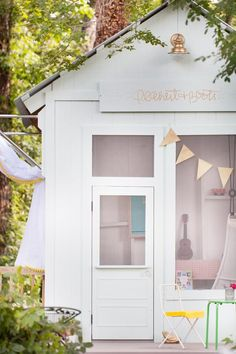 An Amazing Kids' Playhouse Built from an Old Backyard Shed. We're swooning over the transformation!