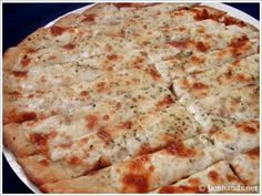 1 premade pizza dough from a pizzeria  olive oil for brushing dough  1 ball of mozzarella (not the kind in water, the kind that is vacuum sealed), you will use about half of a ball, depending on the size of it  1 tablespoon minced garlic, with flavored oil  Italian spices