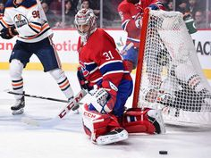 MONTREAL, QC - DECEMBER 09: Goaltender Carey Price #31 of the Montreal Canadiens keeps the puck away while Milan Lucic #27 of the Edmonton Oilers crashes into the net during the NHL game at the Bell Centre on December 9, 2017 in Montreal, Quebec, Canada. (Photo by Minas Panagiotakis/Getty Images)