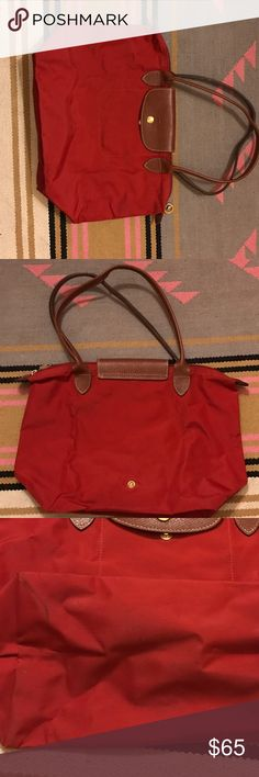 Longchamp Red Le Pliage Medium tote Medium Le Pliage style. Folds up for easy storage/travel. Great classic bag, just not my style anymore. A bit of wear on the bottom and edges (see photos), but overall looks great! Longchamp Bags Totes